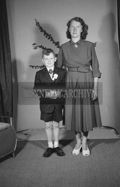 June 1957; A studio Communion photo of Jimmy Flynn with his mother.
