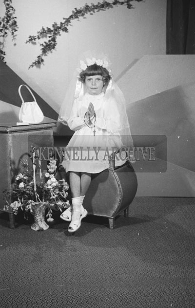 June 1957; A studio Communion photo of Maisie O'Donnell.
