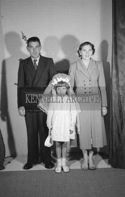 June 1957; A studio Communion photo of Maisie O'Donnell with her parents.