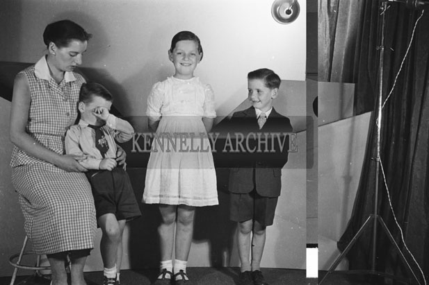 June 1957; A studio photo of the Rohan children with their mother.