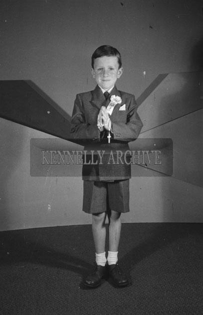 June 1957; A studio photo of a communion boy.