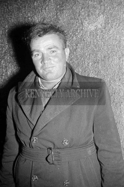 July 1957; A photo of a man.