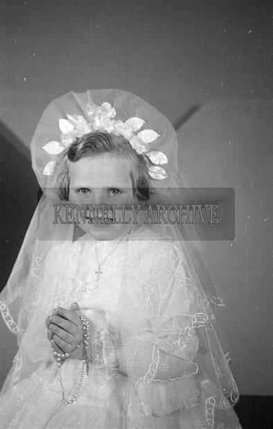 July 1957; A studio communion photo of Miss Farrell.