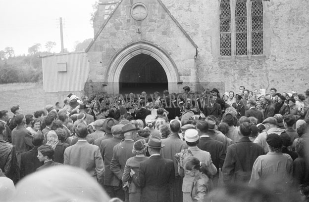 July 1957; The crowd outside the church on the wedding day of Lady Caroline Wyndham Quin, younger daughter of the Earl of Dunraven, to the Marquis of Waterford.