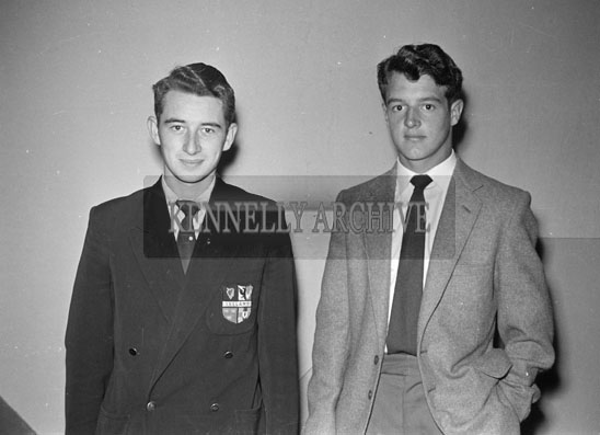 July 1957; A studio photo of two men.