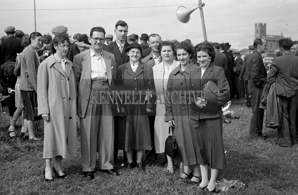 July 1957; A group of people pose for the camera at Ballyheigue Feis.