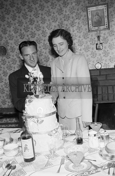 July 1957; A photo of a wedding reception in a house.