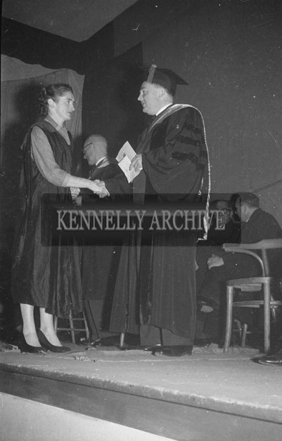 August 1957; A photo taken at a conferring of diplomas.