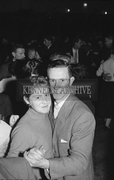 August 1957; A photo of people enjoying themselves at a dance.