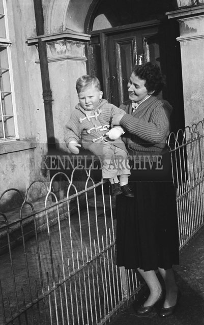 January 1957; A photo of a mother and baby.