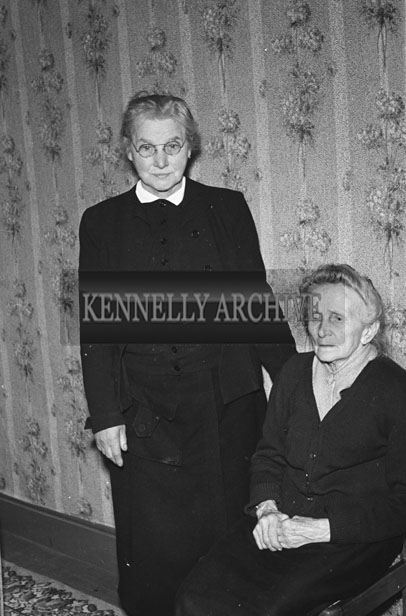 February 1957; A photo of two members of the O'Sullivan family, Aughasla, Castlegregory.
