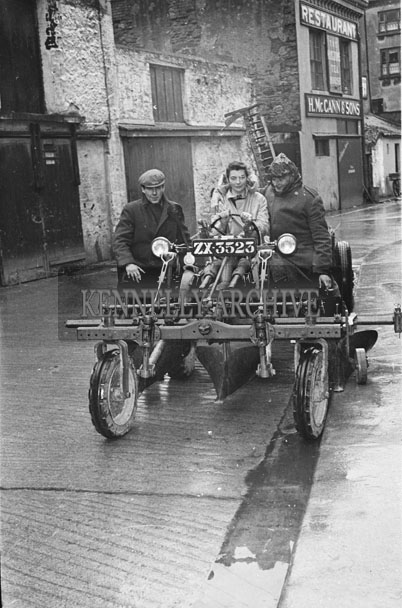 February 1957; Peter Kennelly, Ballylongford (right) shows Joan Kennelly his new David Brown Tractor in Courthouse Lane, Tralee.