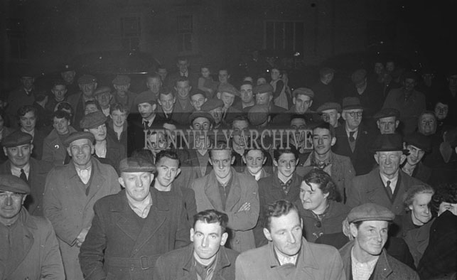February 1957; A photo of the crowd to welcome home the National Ploughing Champions Con Slattery, Ardfert, who won the Two Furrows Event and Denis Healy who won the Three Furrows Event.