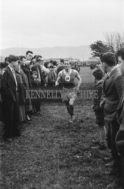 10th February 1957; A photo an athlete competing in the Munster Championship cross-country race.