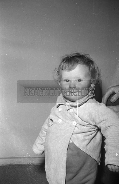 August 1957; A studio photo of a young boy.