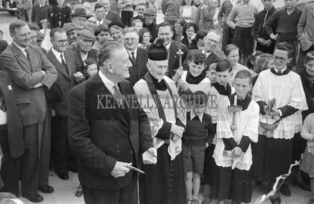 August 1957; Minister for Local Government Paddy Smith cutting the ribbon at the opening of a new housing scheme in Dingle.