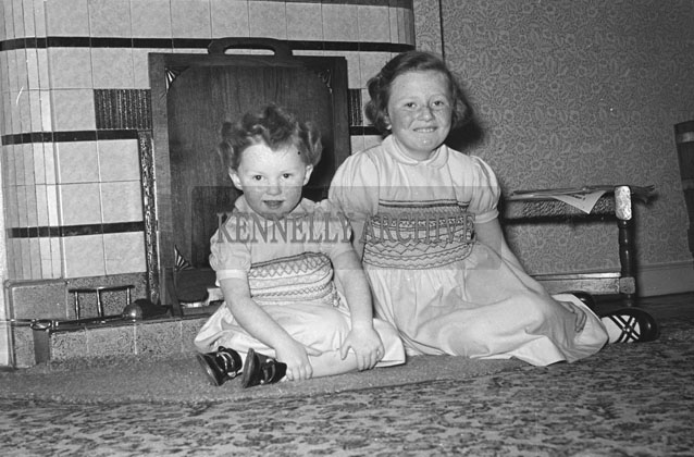 February 1957; A photo of children taken in their home.