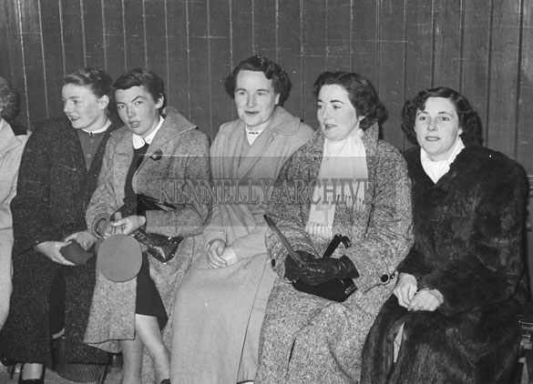 February 1957; Joan Kennelly (second from left) at a table tennis tournament.
