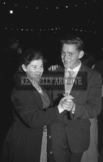 4th September 1957; A photo of a couple dancing in the street at Tralee Carnival.