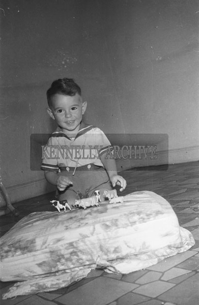 September 1957; A photo of a young boy, taken at home.