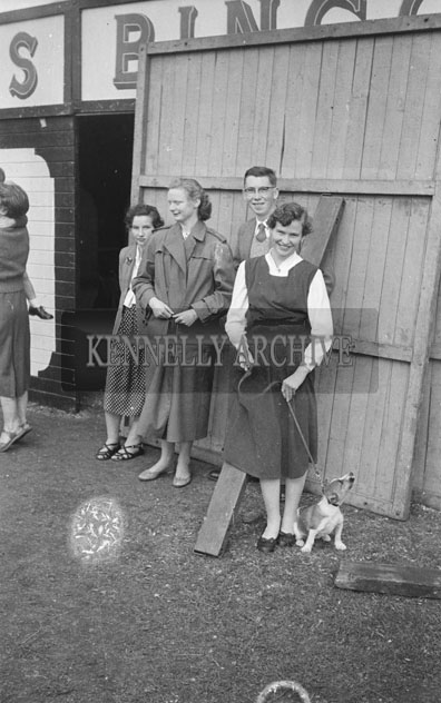4th September 1957; A photo of a group at Bird's Amusements in Tralee Carnival.