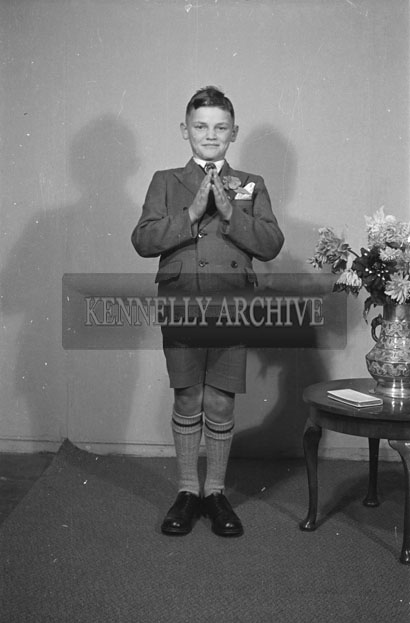 22nd September 1957; A Confirmation studio photo of a boy.