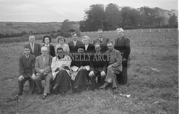 September 1957; A group poses for the camera with Canon O'Sullivan at a blessing ceremony to turn the first sod for the new boys primary school in Listowel.