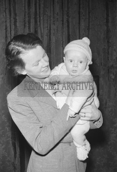 February 1957; A studio photo of Mary Griffin and her baby.