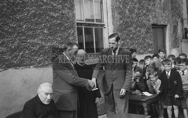 September 1957; A photo taken at the retirement of National Teacher 'Tall' O'Brien in Edward Street CBS.