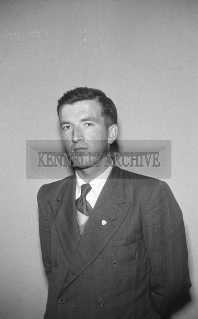 September 1957; A studio photo of a man.