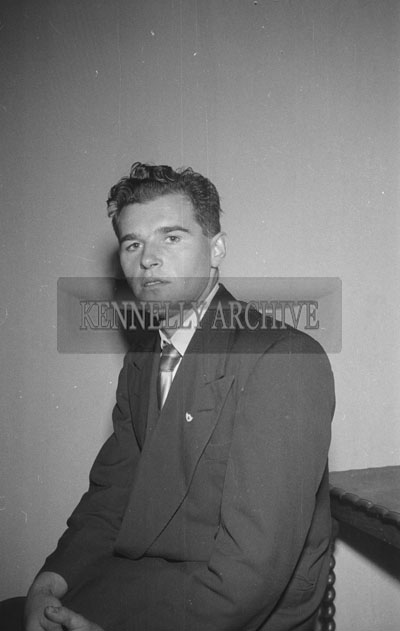 September 1957; A studio photo of a man.