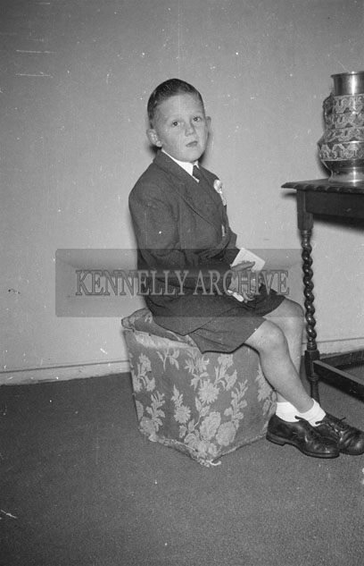 October 1957; A studio Communion photo of the Kennedy Boy.