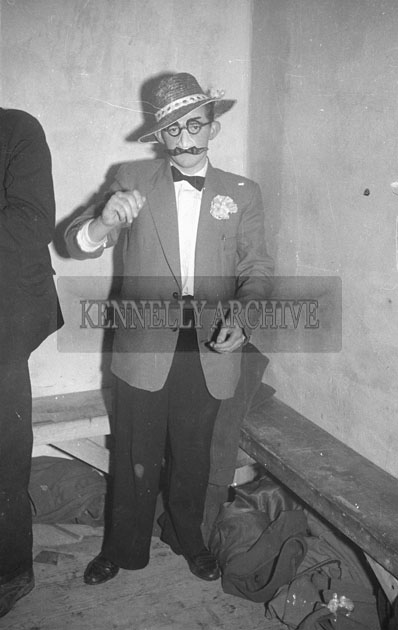 October 1957; A man in fancy dress at the Castleisland Carnival  Fancy Dress Dance.