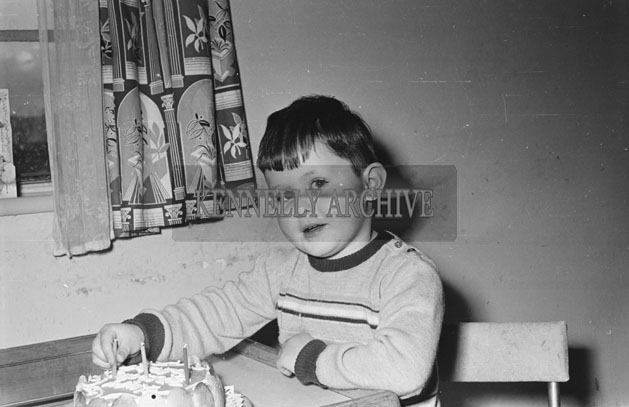 March 1957; A photo of one of the children of John and Patricia Griffin in their home at Clogherbrien, Tralee.
