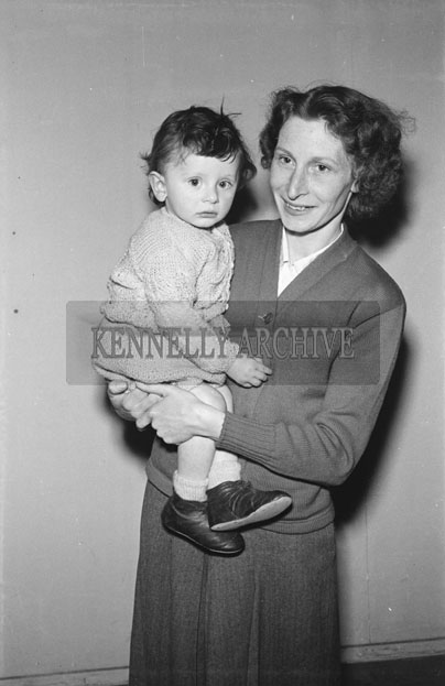 March 1957; A studio photo of a woman and a baby.
