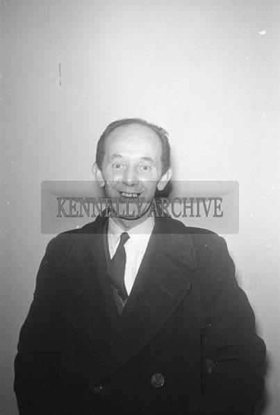 October 1957; A studio photo of a man.