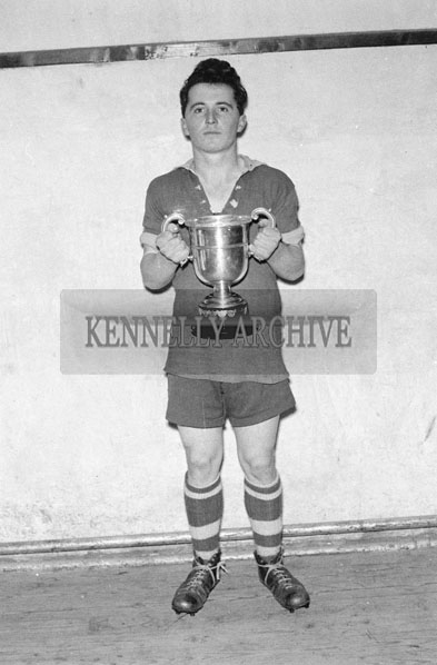 December 1957;  A Footballer from County Football Champions Listowel Technical school holding the Cup.