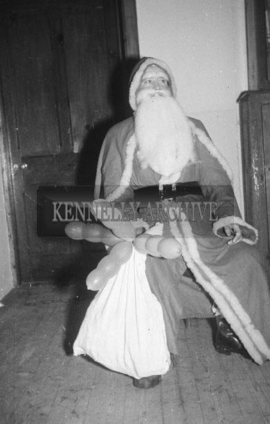 December 1957; A photo of Santa indoors at a Convent School.
