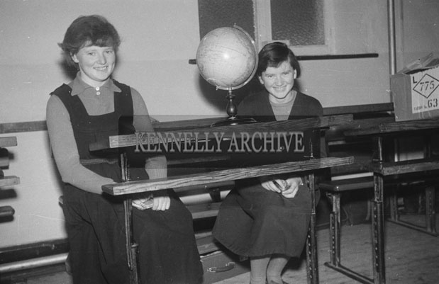 December 1957; A photo of two students indoors at a Convent School.