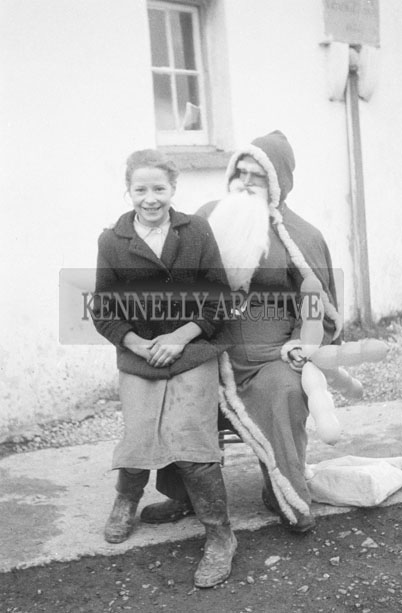 December 1957; A photo of Santa with a student at Dromolough National School.