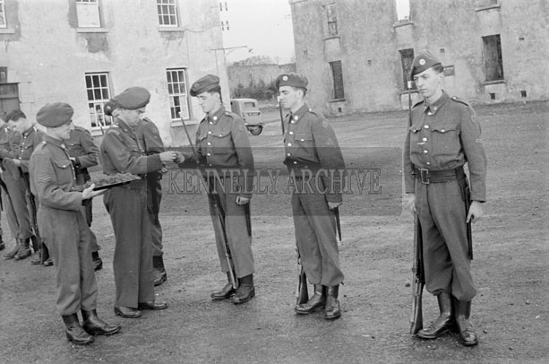 17th March 1957; A photo of the FCA receiving the Shamrock in Ballymullen Barracks before the St. Patrick's Day Parade.