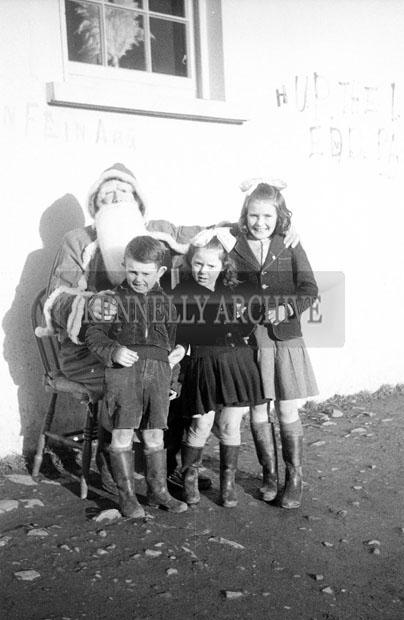 December 1957; A photo of Santa on a visit to Castleisland National School.