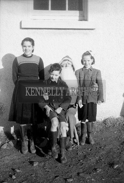 December 1957; A photo of Santa with students on a visit to Castleisland National School.