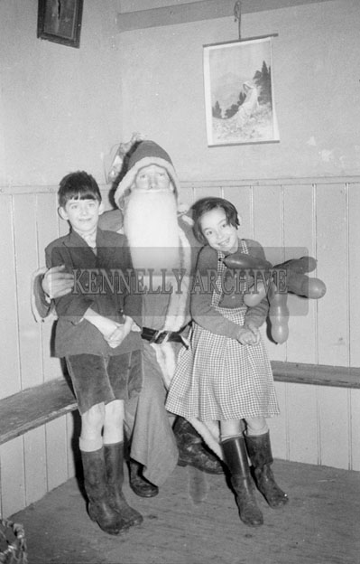 December 1957; A photo of Santa with students on a visit to Coolard National School.