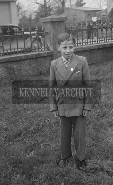 May 1957; A photo of a boy on his confirmation day in Currow.