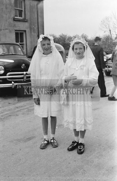May 1957; A photo of two girls on confirmation day in Currow.