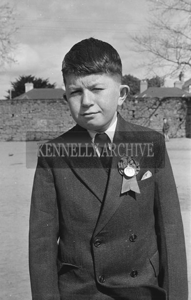 May 1957; A photo of a boy taken on his Confirmation Day in Listowel.