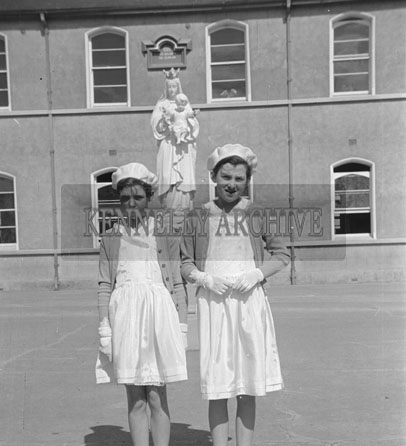 May 1957; A photo of two girls on their Confirmation Day in Listowel.