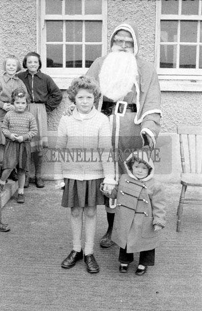 December 1957; A photo of Santa with students in a convent school.