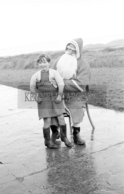 December 1957; A photo of Santa with a student at Realt na Mara National School.